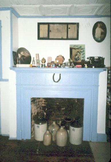 Kitchen fireplace with draft horse shoe found in the chimney.